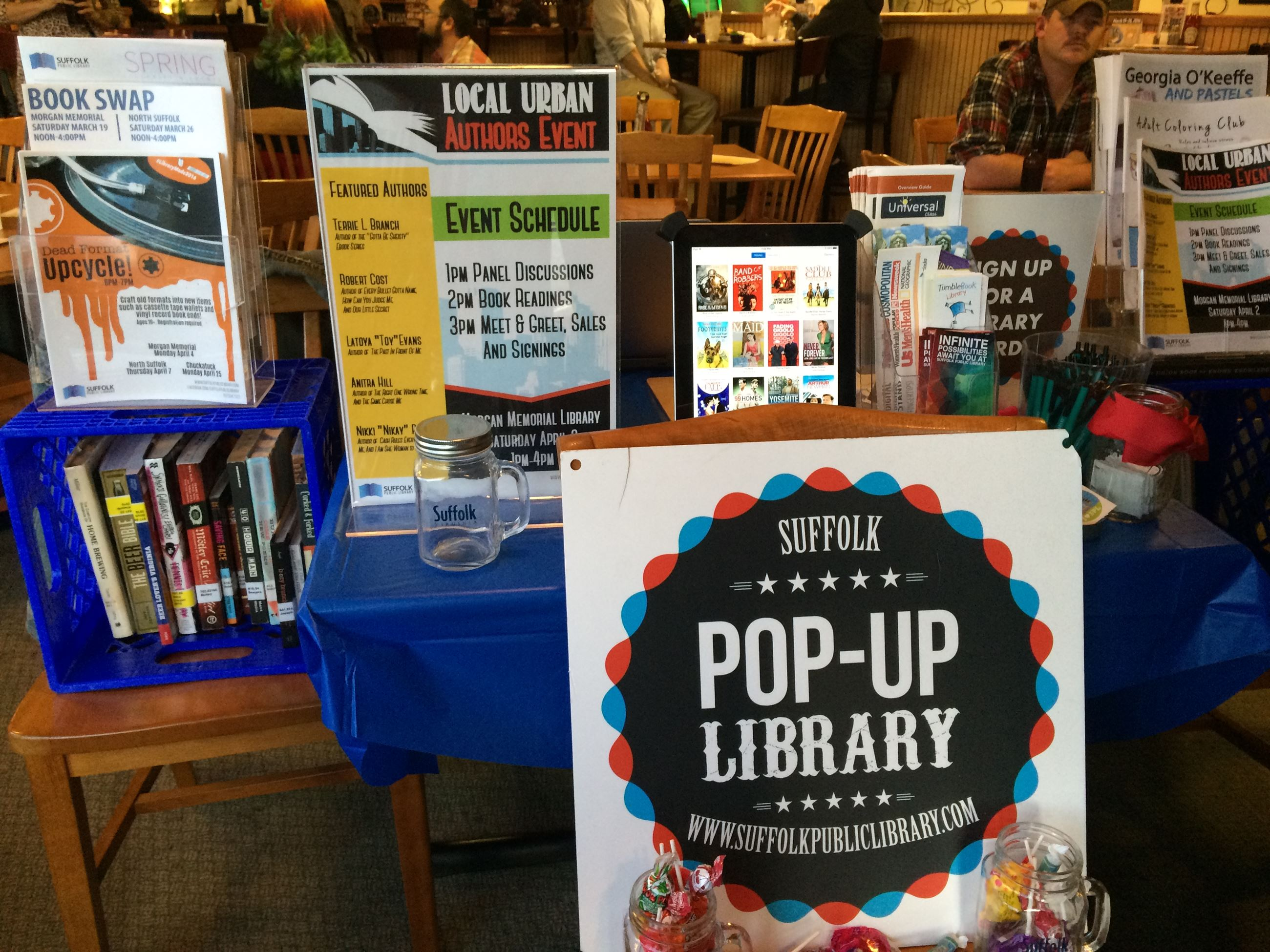 Pop Up Library table with signage and books